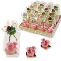 32 pcs Sitting marzipan piglet with clover leaf in plastic bag